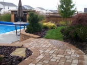 Paver walkway and pool surround with landscaping dayton ohio