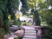 Custom paver walk with with stone stairs in garden in Dayton Ohio